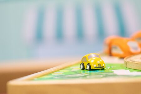 Yellow car model-Traffic road sigh toy, Play set Educational toys for preschool indoor playground (selective focus)