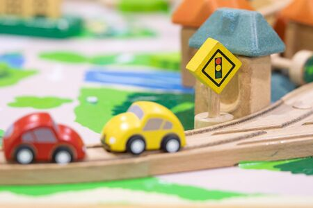 stop road sign - woden Toy Set Street Signs, cars for kids Play set Educational toys for preschool indoor playground (selective focus) Banco de Imagens