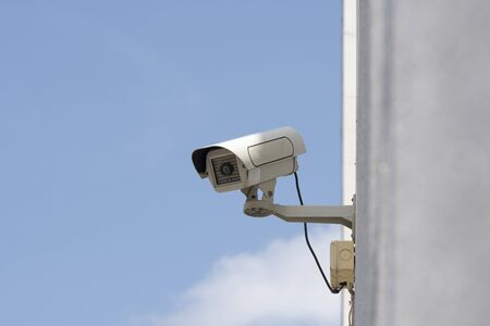 outdoor security cameras in garden , on blue sky background