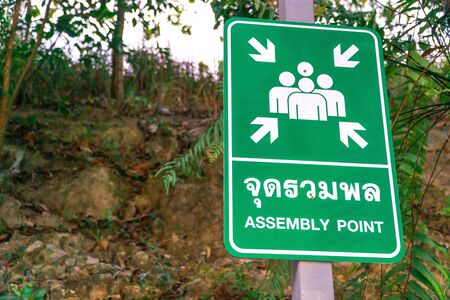 Assembly point signs , are essential for identifying areas of safety where persons should assemble in the event of an emergency Stock fotó