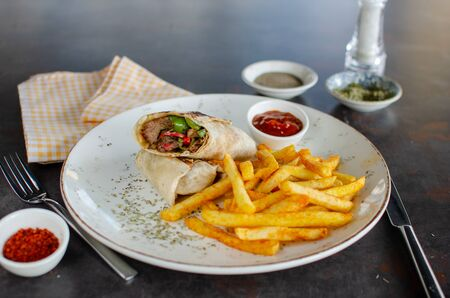 Wrap sandwiches of chicken meat, with fries and sauces