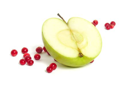 bilberries: half of a green apple with red bilberries