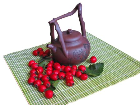 Teapot wiht haw berry on white background photo