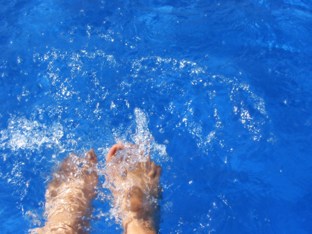 Feet over a pool Stock Photo - 1576633