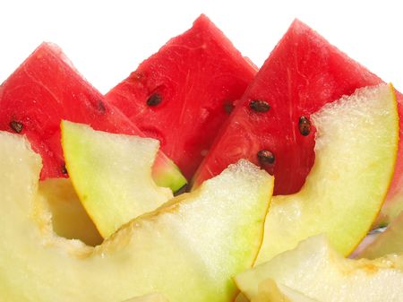 Slices of watermelon and muskmelon isolated on white photo
