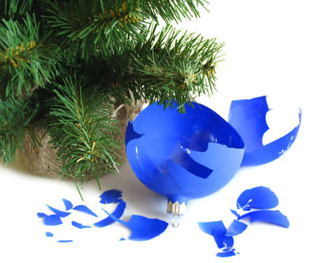 Pieces of broken blue ball with Christmas tree photo
