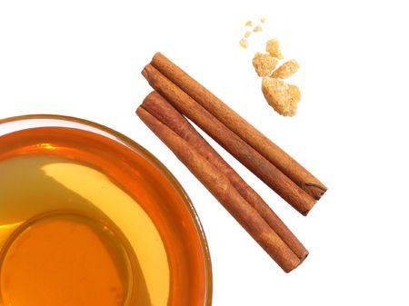 Сup of green tea with cinnamon sticks and sugar photo