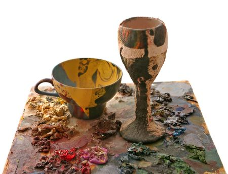 papiermache: Coloured bowl from papier-mache and cup on oil-paint background