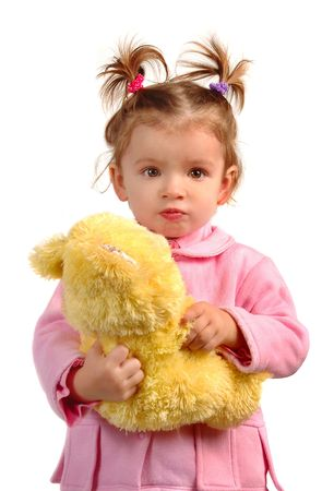 Little girl with her bear toy photo