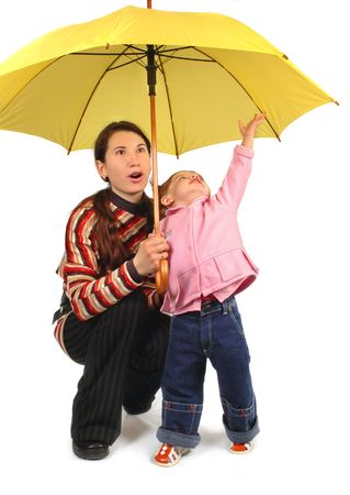 Daughter and mother with yellow umbrella Stock Photo - 2334877