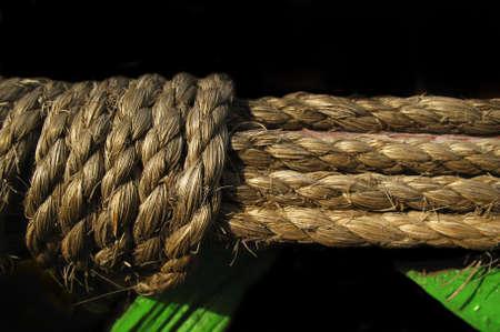 Old rope on black background Stock Photo - 2661872