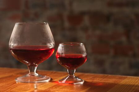 Two wineglasses on on brick wall background Stock Photo - 2707188