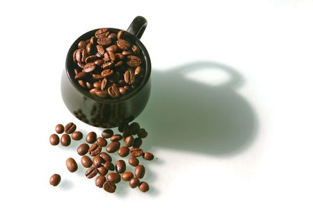 Coffee beans in a little brown cup on a white background photo