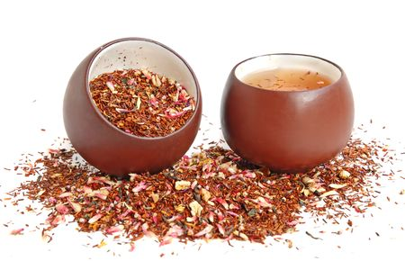 Cup of dried flower and roibos tea leaves with cup of tea Stock Photo - 2811457