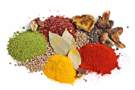 Piles of spices: parsley, red paprika, whole black pepper, white coriander, curcuma, laurel leaves and dry porcini mushrooms. Stock Photo - 2905564