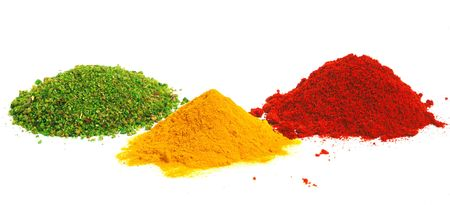 colored powder: Piles of spices. Parsley, oregano, red paprika and curcuma Stock Photo
