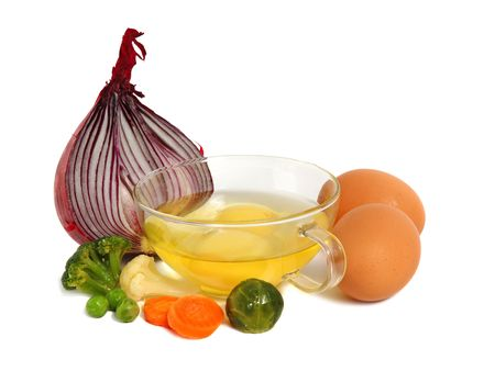 Raw eggs in a glass cup and different vegetables, healthy breakfast. Stock Photo - 2957133