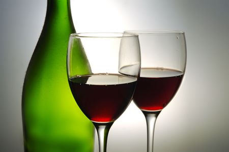 Red wine and green bottle photo