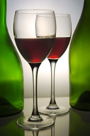 Red wine and green bottles photo