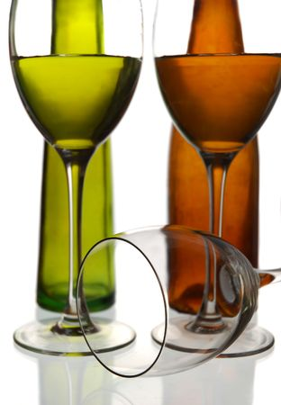 Wine bottles and two glasses with water against a white background photo