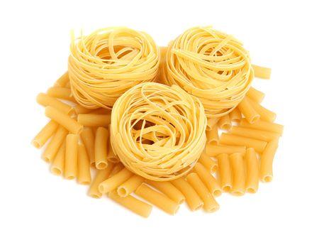 Italian pasta tagliatelle isolated on white photo