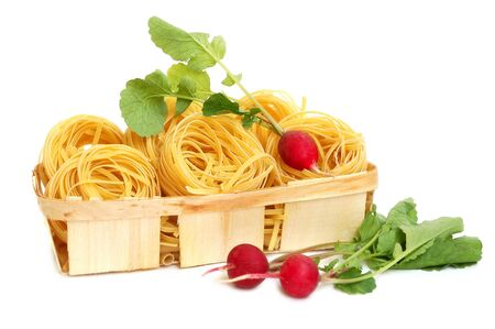 Italian pasta tagliatelle and radish in basket isolated on white Stock Photo - 3114145