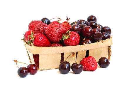 Ripe red strawberries and cherries in a basket Stock Photo - 3237826