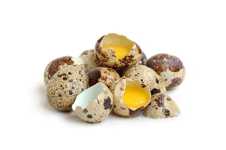 Bunch of quail eggs, two eggs are broken photo
