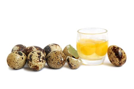 Bunch of quail eggs with yolk in a glass cup, healthy drink for breakfast. photo