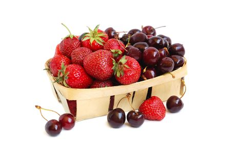 Ripe red strawberries and cherries in a basket photo