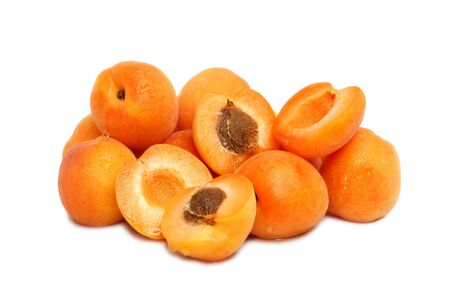 pit fall: Ripe yellow apricots stack on white background