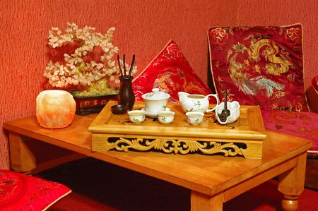 Table for tea ceremony in japanese or chinese restaurant. Interior in red tone. photo