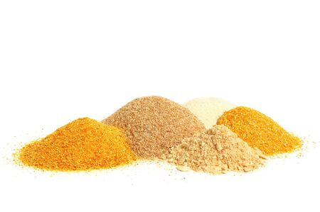 Ingredient for cooking - maize meal, crackers, manna-croup and peeled barley in a pile on white background. photo