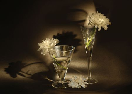 Two glasses and flower in warm light. Photograph is made in lightbrush technique. Low-key lighting. Stock Photo - 3407547