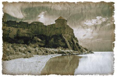 Medieval castle on sea coastline near Odessa, Ukraine. Old textured card, in grunge style. Film grain. photo
