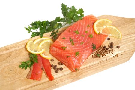 Raw salmon fillet on a wooden cutting board Stock Photo - 3442390