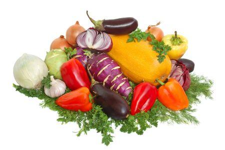 Yellow squash, kohlrabi, onion, garlic and greens on white background photo