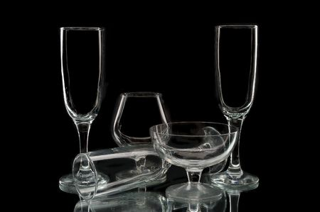 Empty wine glasses against a black background photo