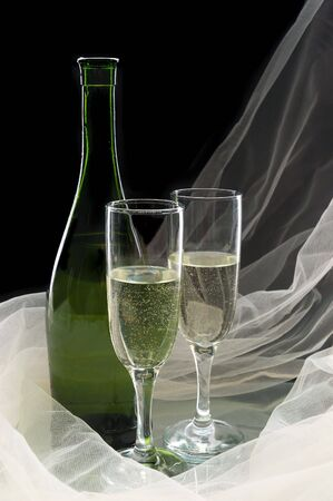 Champagne against a black background photo