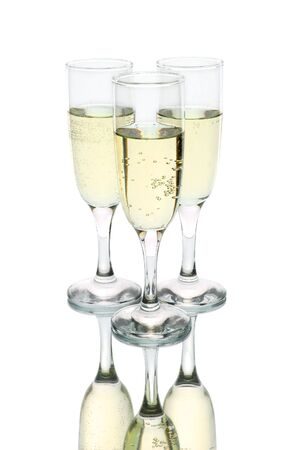 Champagne flutes against a white background photo