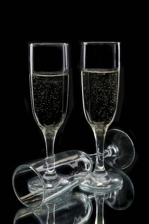 Champagne flutes against a black background photo