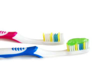 Closeup of a toothbrushes with toothpaste photo