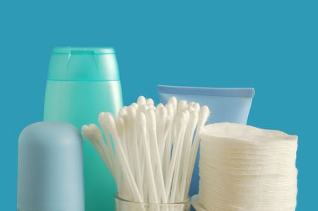 Cotton buds and pads on blue background photo