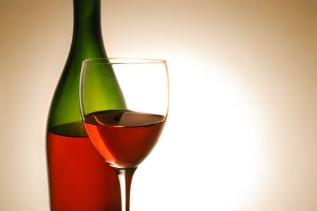 Red wine and green bottle on white background photo