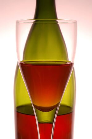 Red wine and green bottle on pink background Stock Photo - 4324518
