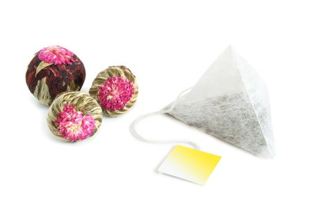 Aromatic dried flower green tea bolls and pyramidion tea bag photo