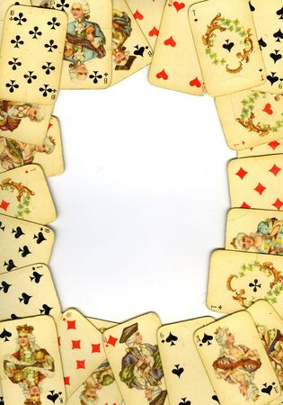 playing with money: Frame from old playing cards on white background Editorial