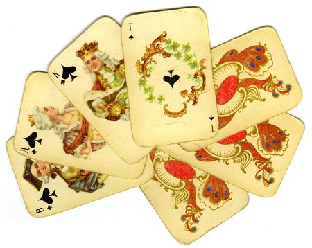 Old playing cards on white background