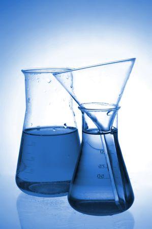 volumetric flask: Chemical retorts on glass table