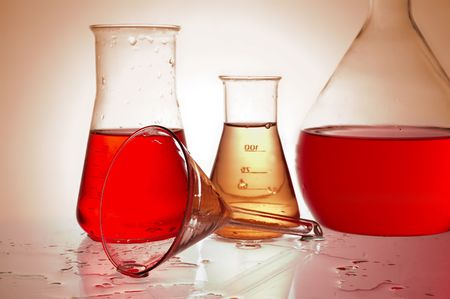 Chemical retorts on glass table photo